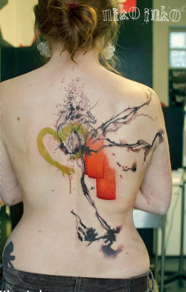 Abstract style colored back tattoo of human heart with various ornaments