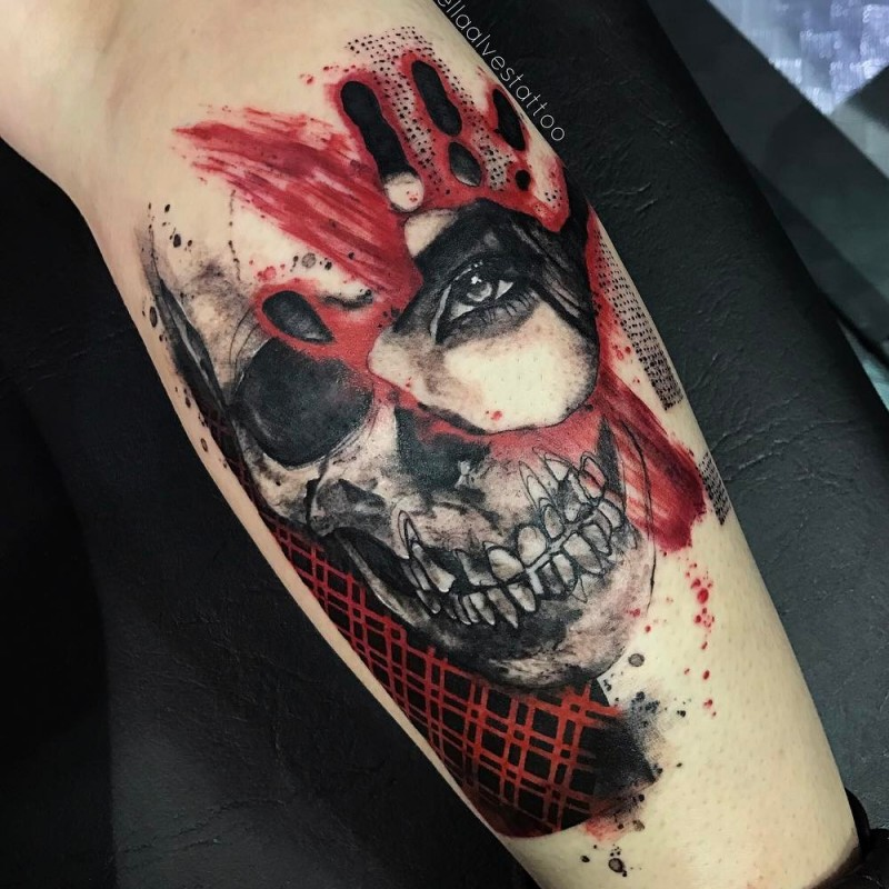 Abstract style colored leg tattoo of skull with hand print