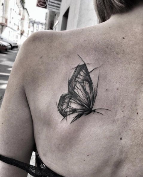 Accurate black ink scapular tattoo of butterfly by Inez Janiak