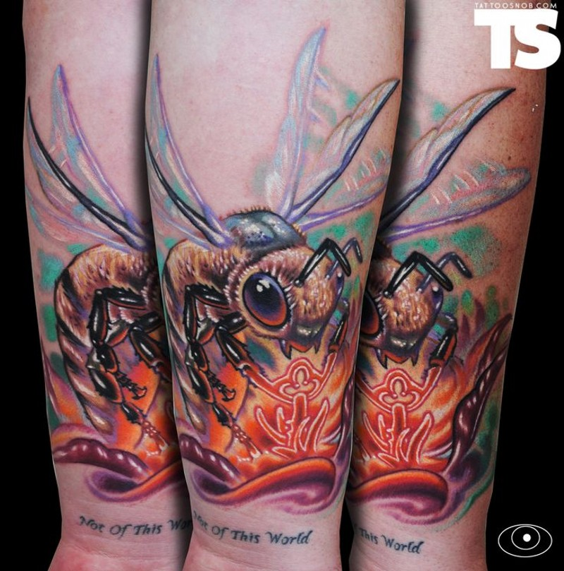Accurate painted and colored forearm tattoo of flying bee and glowing flower