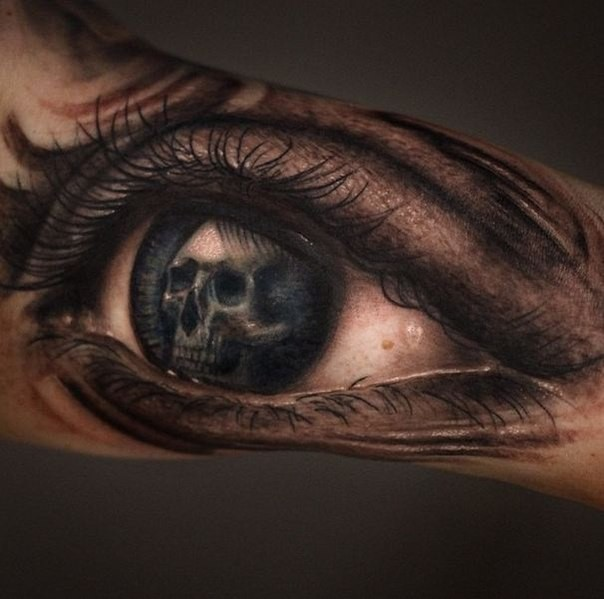 Accurate painted colored woman eye tattoo stylized with human skull