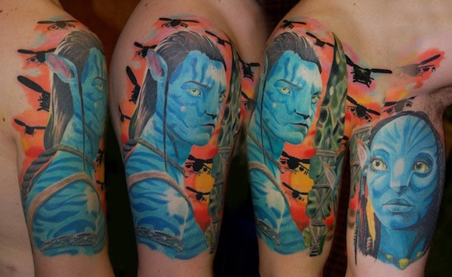Accurate painted movie like colored Avatar heroes tattoo on shoulder combined with military helicopters