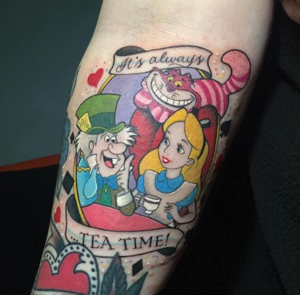 Alice in Wonderland fairy tale heroes having tea multicolored forearm tattoo with banner lettering