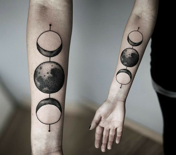 Amazing black ink sun and moon forearm tattoo