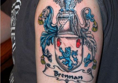 Amazing brennan family crest tattoo on half sleeve