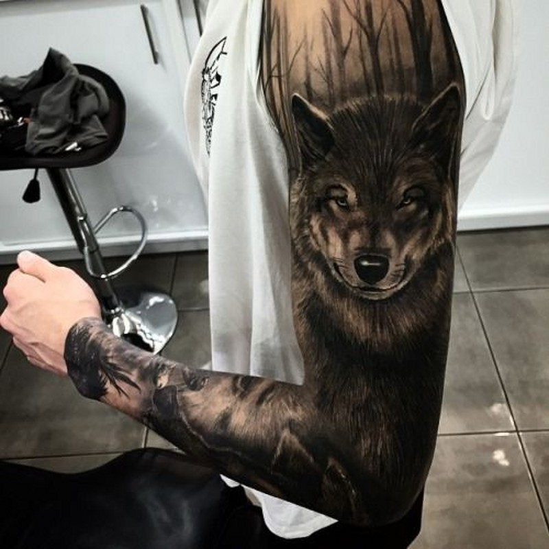 Amazing dark wolf among trees tattoo on full sleeve