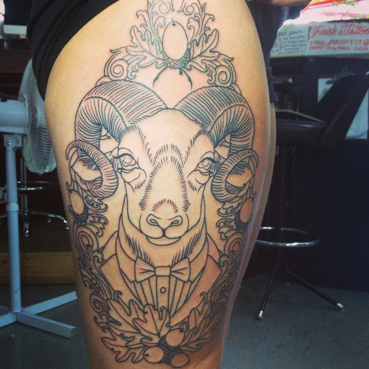 Amazing ram tattoo with flowers