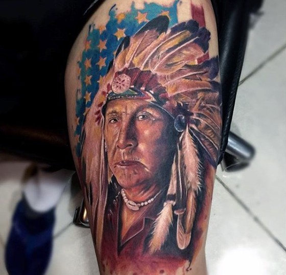 American native big colored old Indian portrait tattoo on arm stylized with national flag