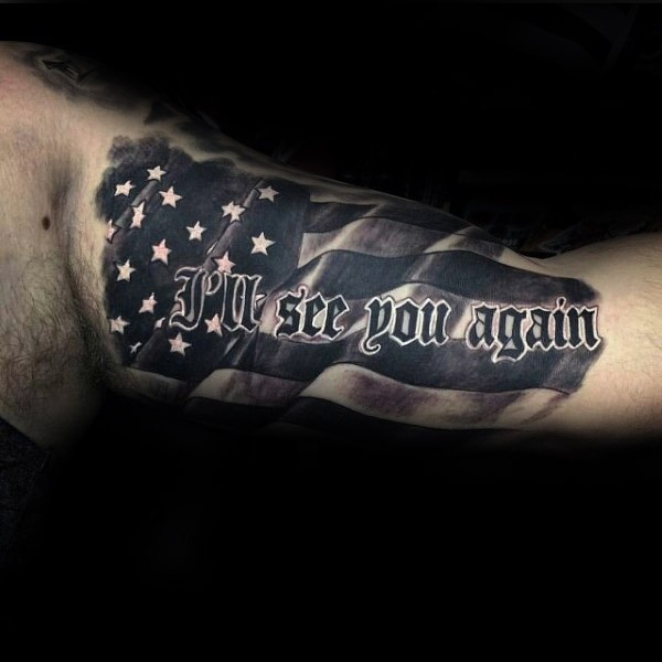 American native colored arm tattoo of flag with lettering