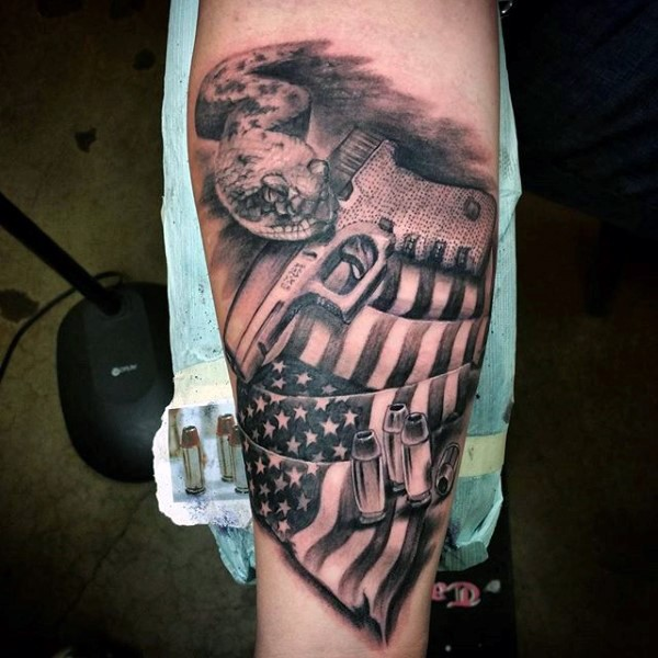 American native colored forearm tattoo of national flag with pistol and snake