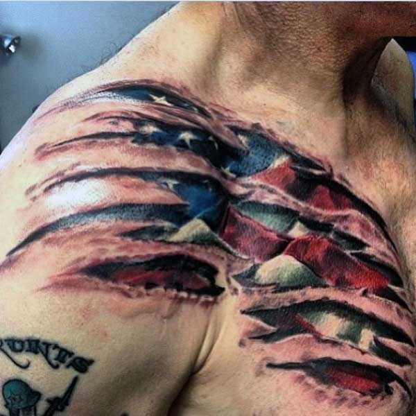 American native multicolored ripped skin with national flag tattoo on chest