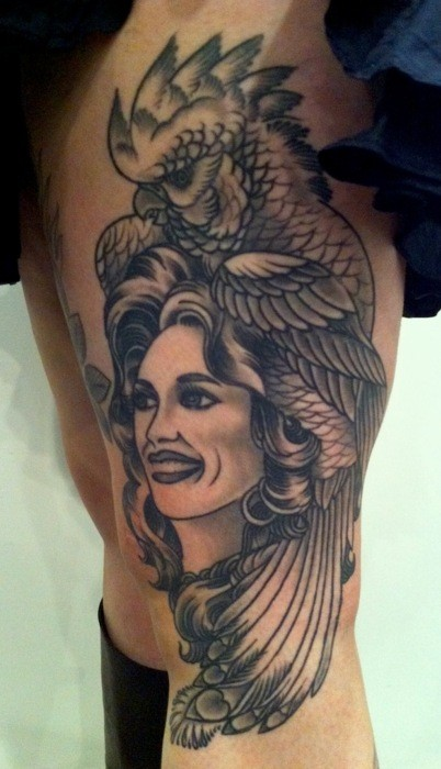 American traditional black and white thigh tattoo of woman with parrot