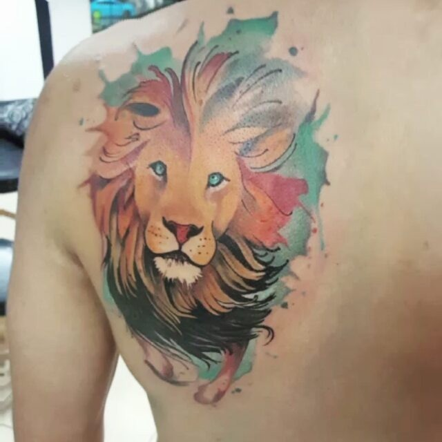 Art style colored scapular tattoo of lion head