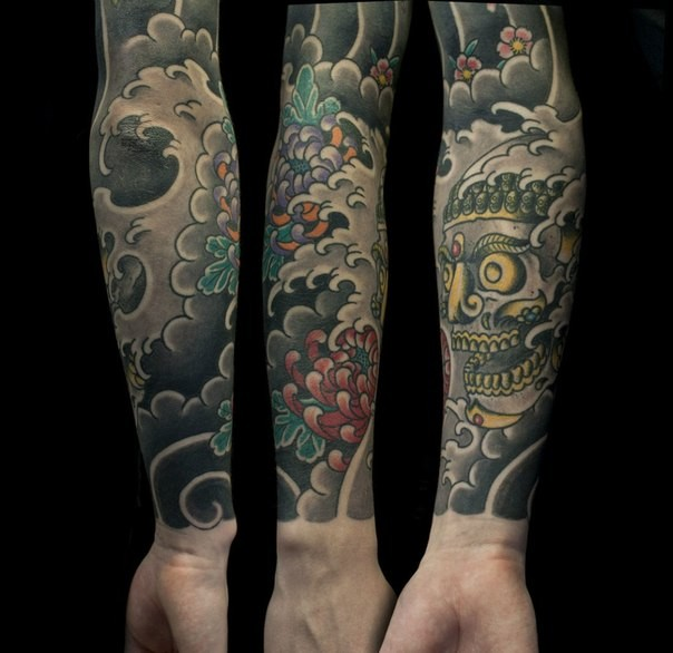 Asian oriental style colored demon sleeve tattoo with chrysanthemum flower in water waves