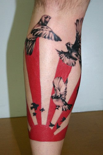 Asian style colored leg tattoo of sun with flying birds
