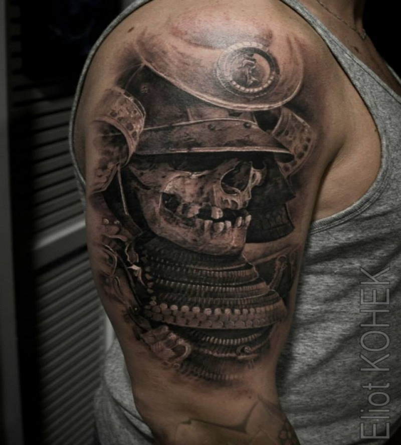 Asian traditional style upper arm tattoo of samurai suit with human skull
