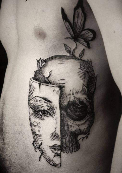 Awesome black gray skull with mask tattoo on ribs