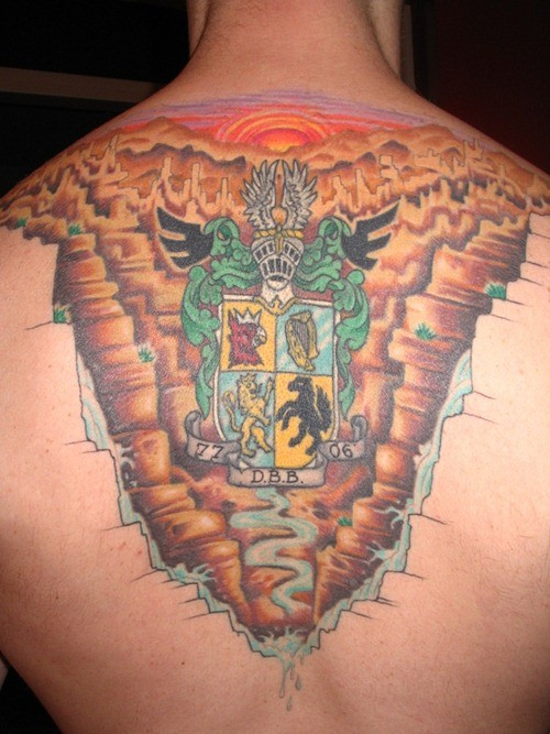 Awesome coloured family crest tattoo on back