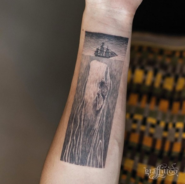 Awesome creative looking forearm tattoo of small sailing ship with whale