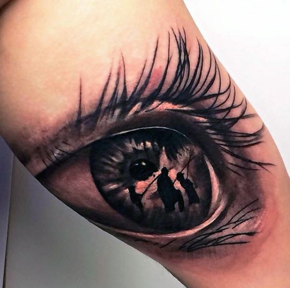 Awesome designed black ink realistic eye stylized with fishing family tattoo on thigh
