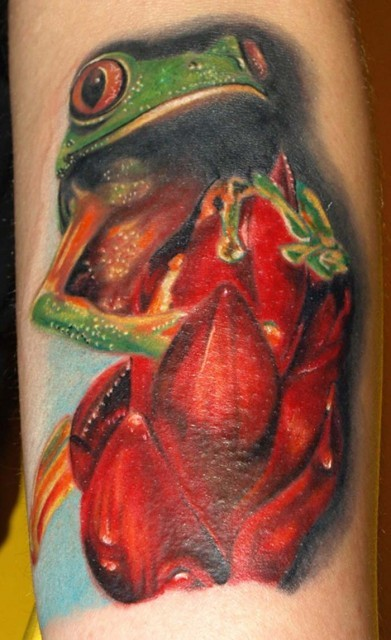 Awesome frog with red flowers tattoo