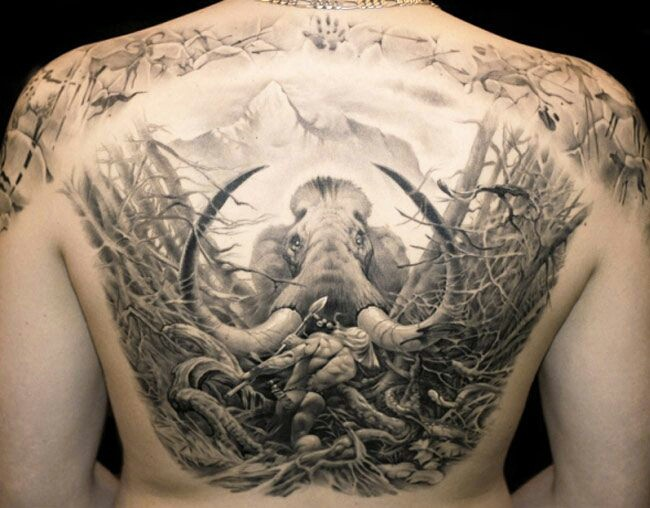 Awesome great mammoth tattoo on whole back