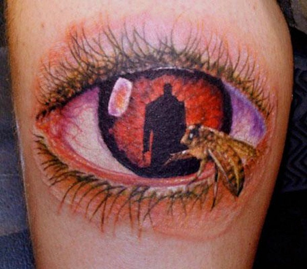 Awesome painted big colored mystical eye with bee tattoo on leg