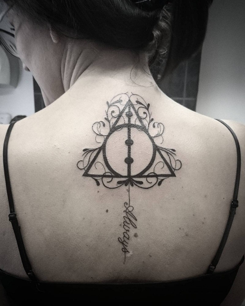 Awesome painted black ink Geometric tattoo on upper back with tiny lettering