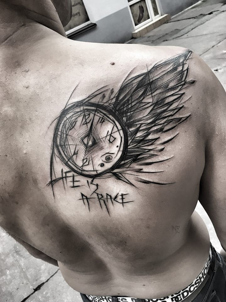 Awesome sketch style black ink scapular tattoo of clock with wing and lettering by Inez Janiak