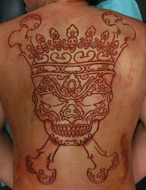 Awesome skin scarification skull with crown