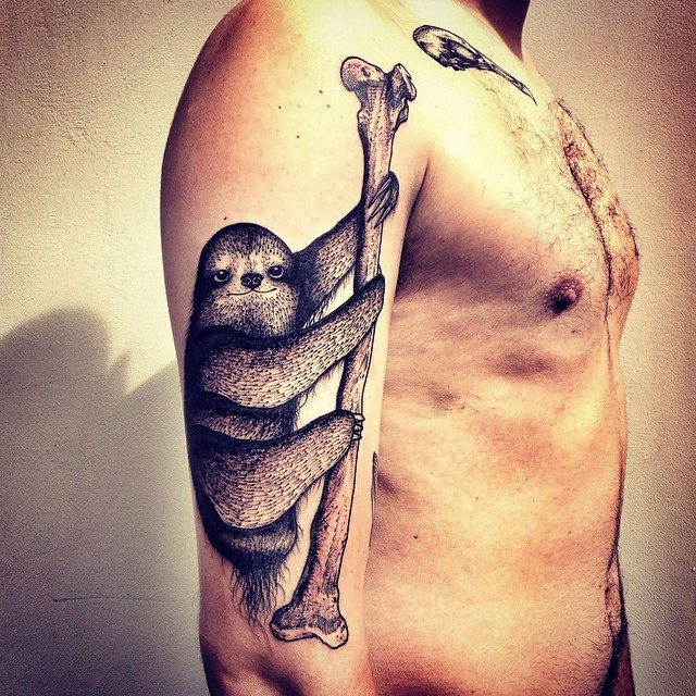 Awesome sloth crawling on bone tattoo on half sleeve
