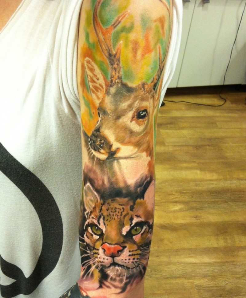 Awesome watercolor animal tattoo on full sleeve