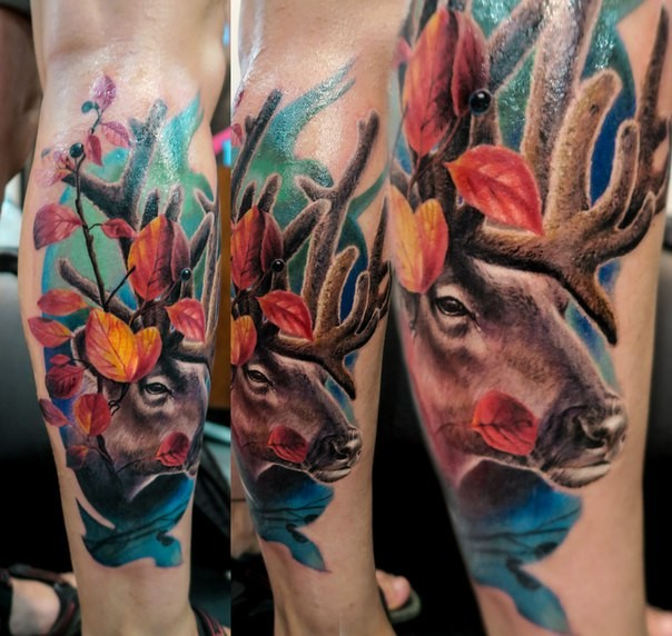 Beautiful colored leg tattoo of deer head with leaves