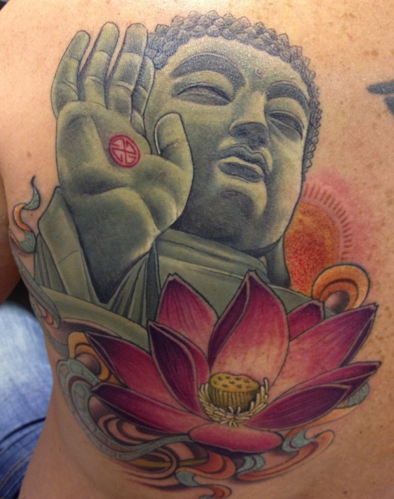 Beautiful coloured buddha and lotus tattoo on whole back