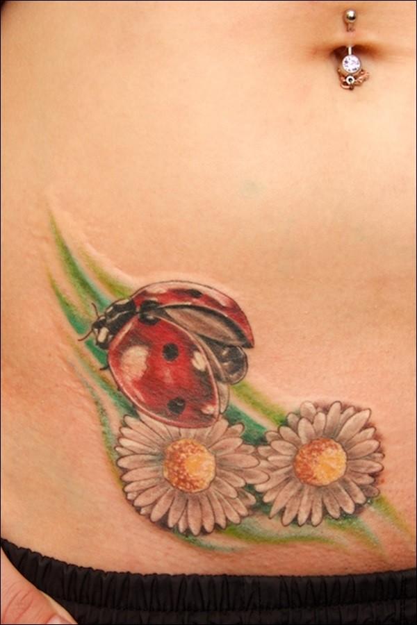 Beautiful coloured ladybug and flower tattoo