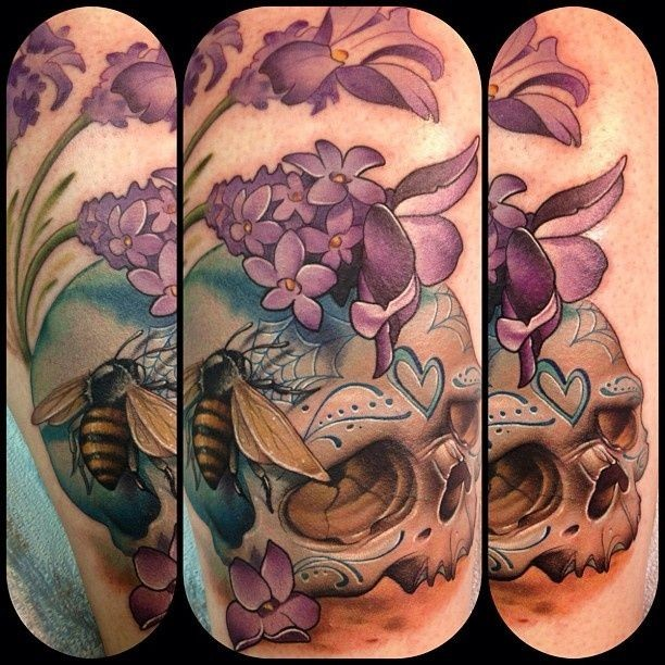 Beautiful designed colored human skull tattoo combined with flowers and bee