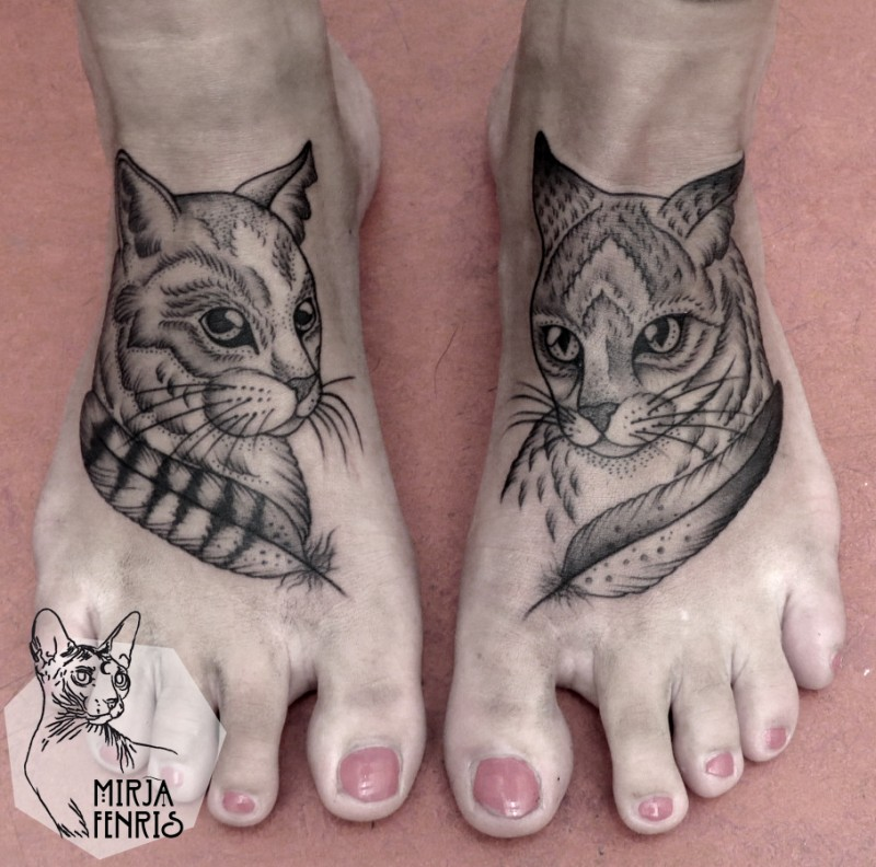 Beautiful dot style black ink feet tattoo of nice cats with feather