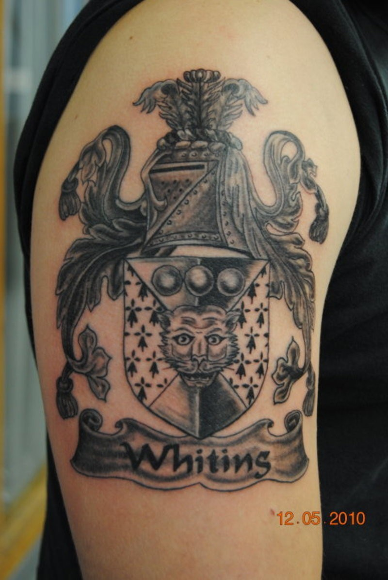Beautiful gray ink family crest tattoo on half sleeve