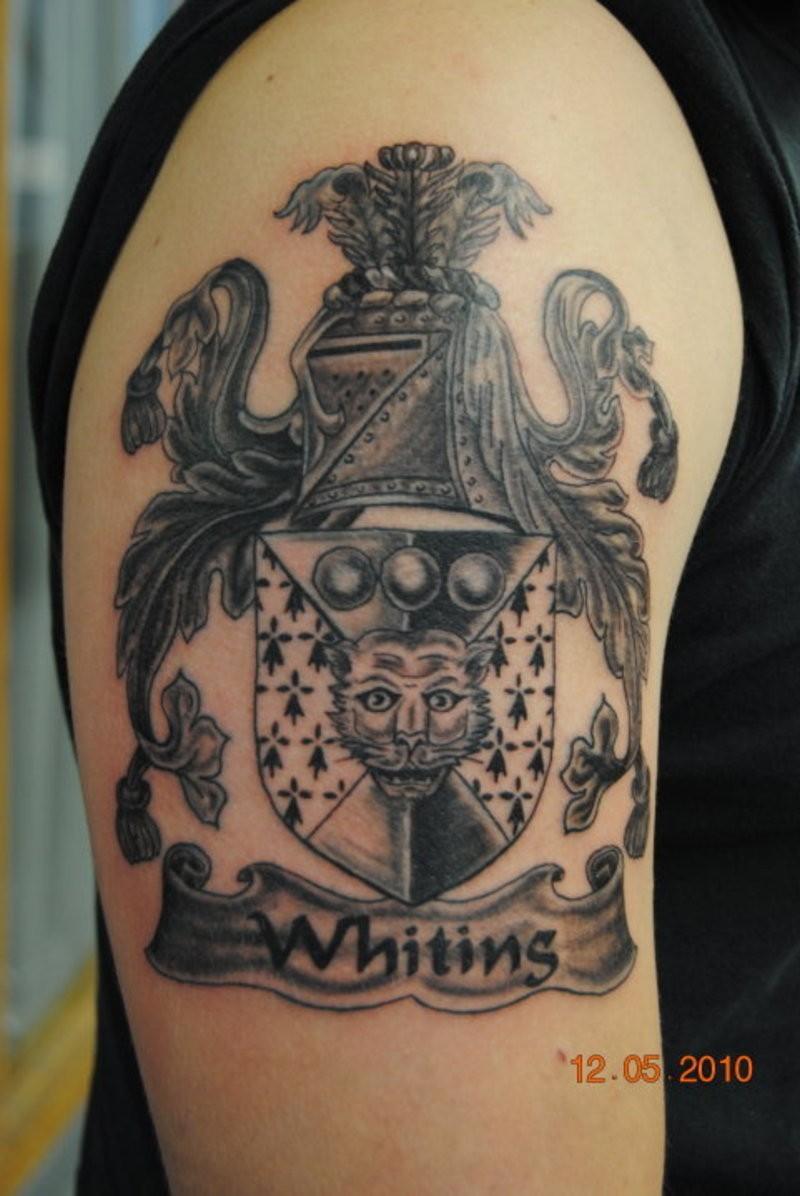 Beautiful gray ink family crest tattoo on half sleeve