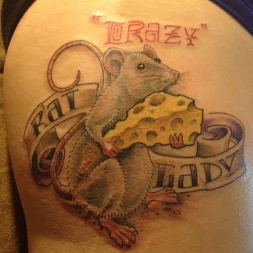 Beautiful gray rodent with cheese and banner lettering tattoo on thigh