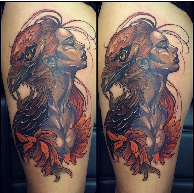 Beautiful looking colored thigh tattoo of woman with eagle head