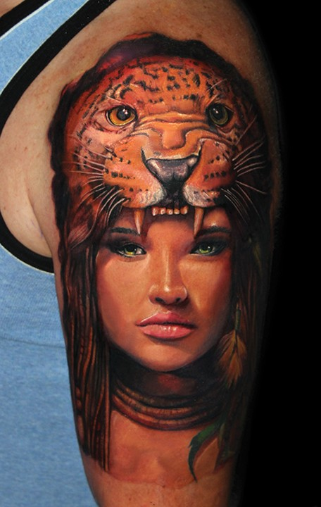 Beautiful painted natural looking shoulder tattoo of woman with leopard helmet