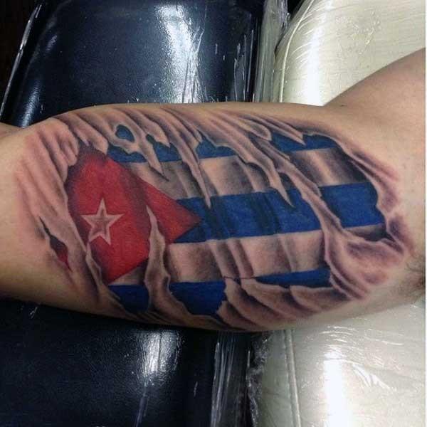 Big 3D like ripped skin tattoo with national flag tattoo on biceps