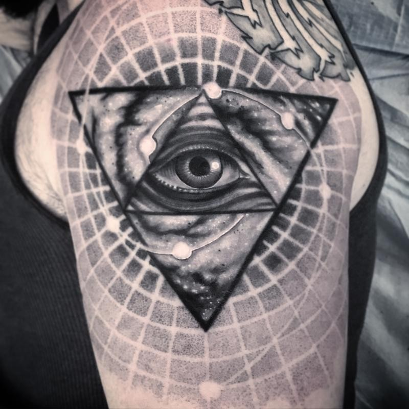 Big accurate painted in dotwork style shoulder tattoo of triangle with human eye