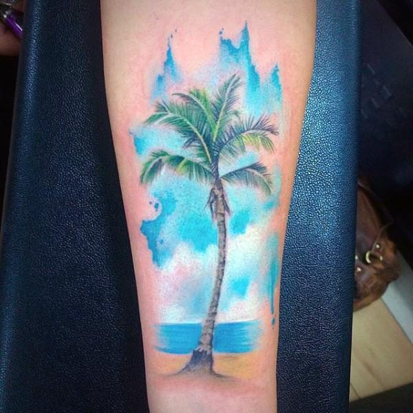 Big beautiful colored palm tree on ocean shore arm tattoo