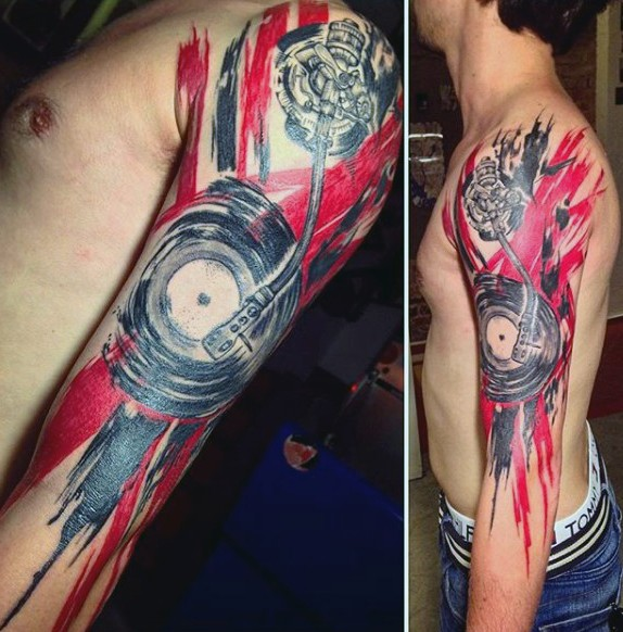 Big black ink musical themed tattoo with national flag tattoo on arm