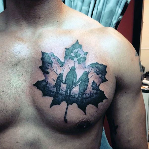Big colored maple leaf stylized with walking family tattoo on chest
