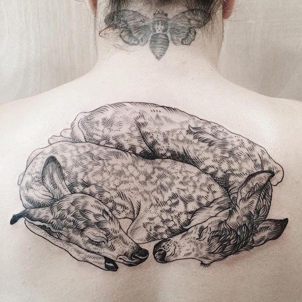 Big engraving style black ink back tattoo sleeping deer family