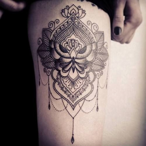 Big linework style painted by Caro Voodoo butterfly tattoo with floral ornaments