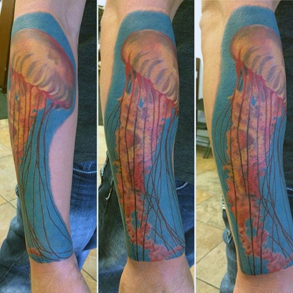 Big realistic painted and colored big jellyfish tattoo on arm